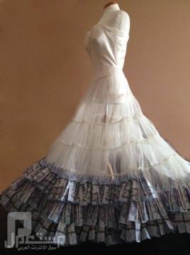 بالصور.. سعودية تصمم فستاناً من النقود مستخدمة مليون ريال من فئة الـ 500