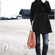 مجموعه متميزة من الملابس النسائية الاعلان الثالث 9- معطف نسائي أسود اللون والمقاس لارج بصفين زراير وحزام وسط