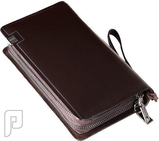 مجموعه من الحقائب والمحافظ الرجالية المتميزة محفظة رجالية ذات لون بني ماركة زفر تحمل باليد مصنوعة من الجلد الطبيعي