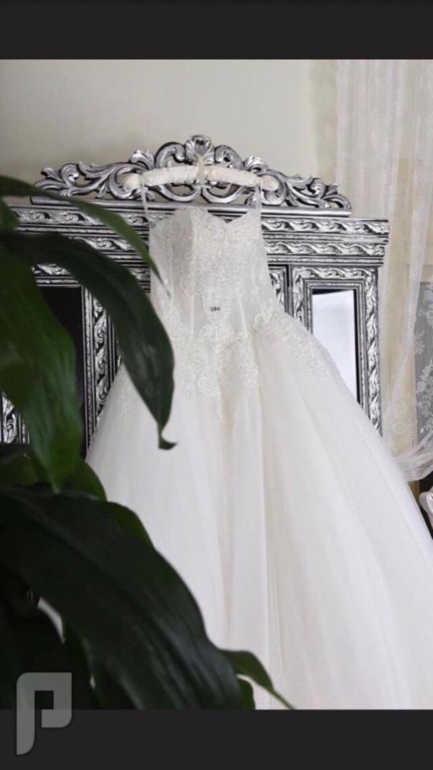 فستان زواج من بوتيك ( RN ) ..