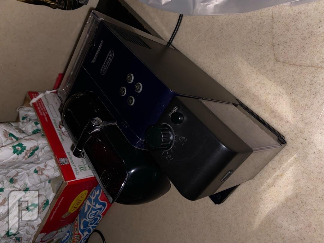 مكينة قهوة من نسبريسو مع الحليب